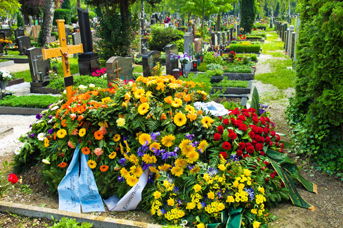 headstone-covered-in-flowers