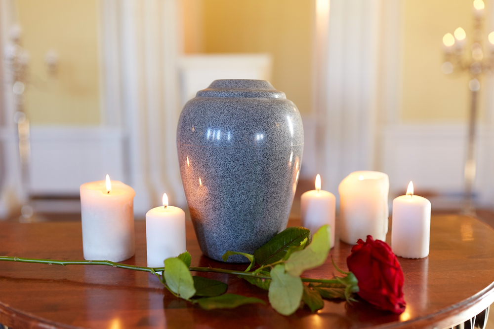 cremation-urn-on-table-candles-flowers
