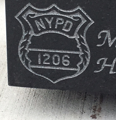 nypd emblem on headstone